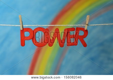 Red letters spelling the word power to illustrate the concept of empowerment, strength and leadership.