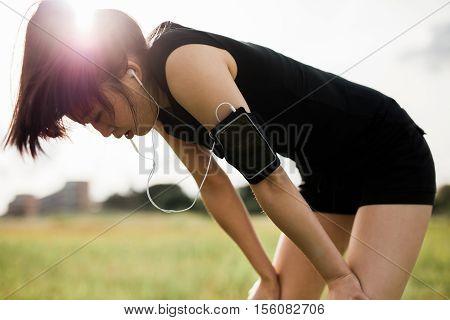 Sportswoman Taking Break From Running Workout.