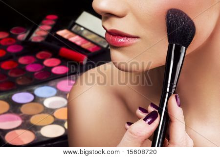 Makeup artist applying blusher