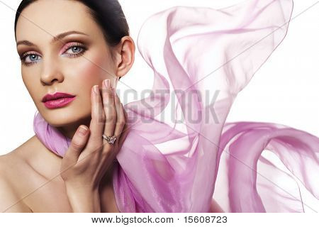 Beautiful woman with diamond ring and pink color scarf