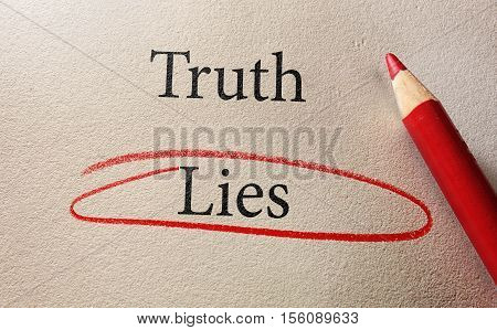 Lies circled in red with Truth text and pencil on textured paper