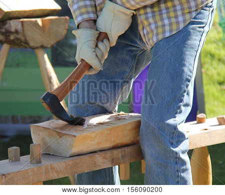 A Traditional Craftsman Shaping a Block of Wood.