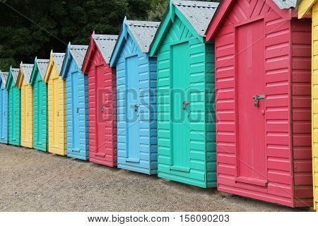 A Collection of Wooden Beach Huts at the Seaside.