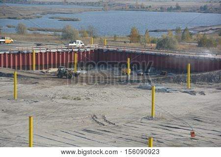 A new port is being built. Before this, a brown coal mine was built here. Now a lake is in the making.