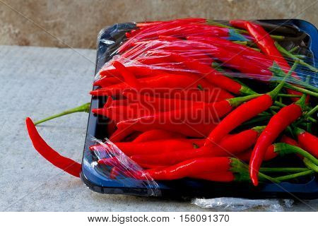 hot red chili or chilli peppers red hot on floor background