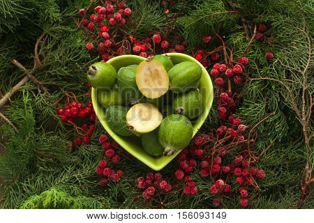 Feijoa source of iodine and vitamins for a healthy diet. Bowl full of feijoa, exotic fruit.