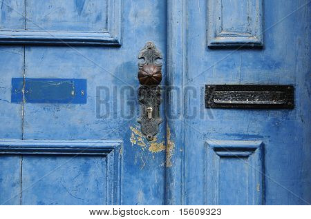 beautiful blue door with mail slot