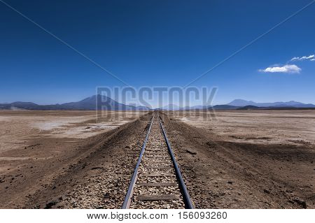 Train tracks in the desert in the Potosi Region in Bolivia South America; Concept for travel in Bolivia and the Andes