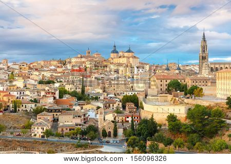 Old city of Toledo with Primate Cathedral of Saint Mary, churches of San Ildelfonso, San Roman and Santo Tome at sunset, Castilla La Mancha, Spain.