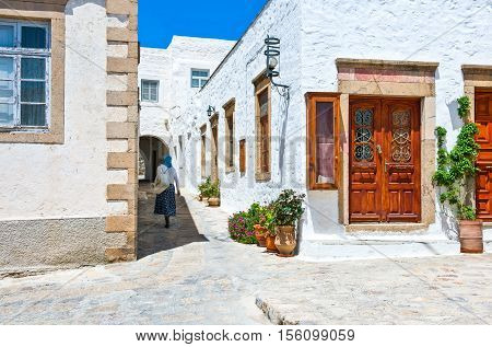 Patmos Greece - May 16 2010: A woman walking in the shadow in he Chora village