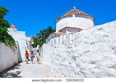 Patmos Greece - May 16 2010: Girls walking in the Chora village