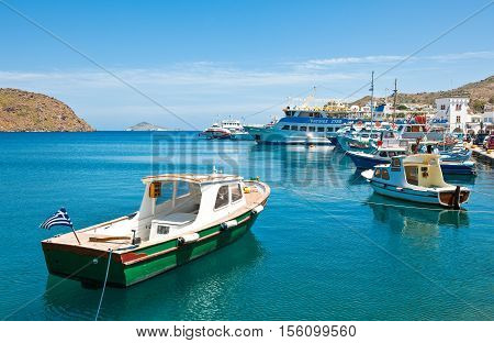 Patmos Greece - May 16 2010: Boats in the harbor of the Skala village