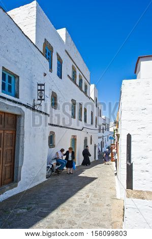 Patmos Greece - May 16 2010: People in the Chora village