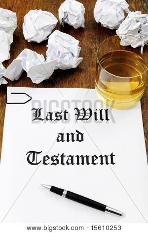 Last Will and Testament  and glass of whiskey on a wooden desk