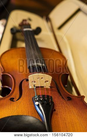 Closeup of a beautiful violin in a case.