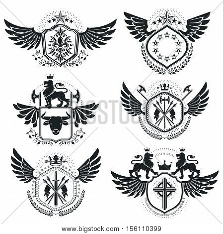 Vector emblems made with armory and royal elements, vintage heraldic designs set decorated using wings.