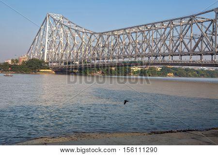 Historic Howrah bridge on river Ganges at Kolkata - the longest cantilever bridge in India. poster