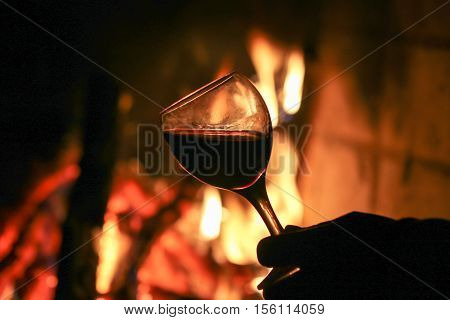Drink wine in front of the fireplace.