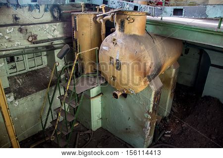Old equipment tank alcoholmeters in an abandoned Voronezh Distillery