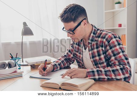 Portrait Of Hardworking Student With Book Preparing For Test In University
