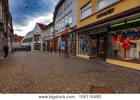 STAVANGER, NORWAY - OCTOBER 9, 2016: Unidentified people walking on the sidewalk of a shopping street in Stavanger, Norway.