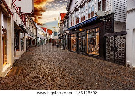 Shopping street at sunset in Stavanger Norway.