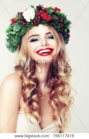 Cute Woman with Blond Permed Hair Red Lips Makeup and Green Christmas Wreath