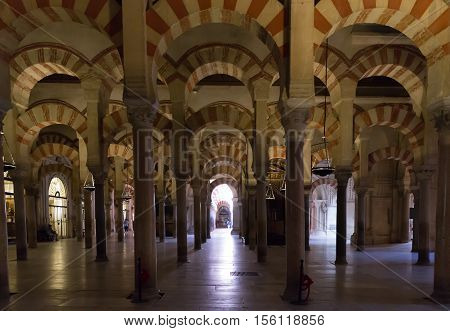 CORDOBA SPAIN - JUNE 3: Interior view of La Mezquita Cathedral on June 3 2014 in Cordoba Spain. The cathedral was built inside of the former Great Mosque. Popular tourist destination in Spain.