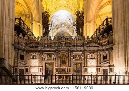 SEVILLE SPAIN - JUNE 4: Interior of Cathedral of Seville on June 4 2014 in Seville Spain. World Heritage Site since 1987 It is the largest Gothic in the world.