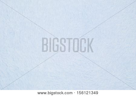 Pale blue plush fabric background with muted mix of colors to provide copy-space for your message