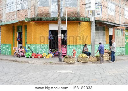 Jinotega Nicaragua - June 11 2015: Local woman sells fresh produce in the historic center of a small town of Jinotega Nicaragua on June 11 2015