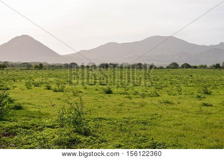 Hazy volcanic landscape of the fields and mountains in the village by Puerto Momotombo in the vicinity of Momotombo volcano Nicaragua