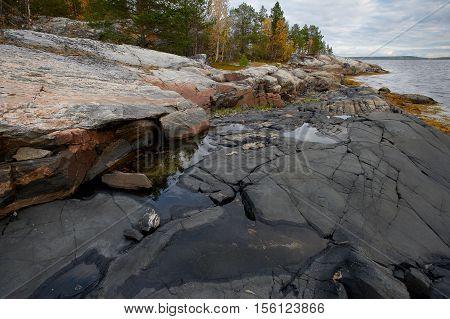 Rocky coast on White sea in autumn on Kola peninsula Russia