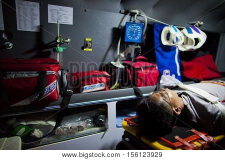 An injured lying inside an ambulance after involved in motocyled accident February 07 2010. This is the case of motocycle vs motocycle. This EMT belongs Sawang Prateep Volunteer Rescue Team. Sawang Prateep is one of many volunteer organization in Thailand