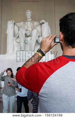 Washington DC USA - September 27 2014: Tourists take photos and pose in front of the Iconic Lincoln statue at Lincoln Memorial Washington DC USA