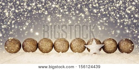 Silver star and christmas balls.Christmas decoration with snow and star isolated on gray bokeh background.