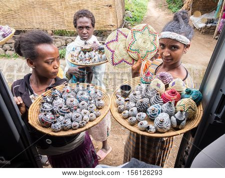 SEMIEN MOUNTAINS, ETHIOPIA - JULY 01, 2016: Ethiopian women selling crafts and souvenirs in Semien Mountains.