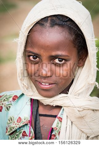 AXUM ETHIOPIA - JUNE 30 2016: Portrait of a young Ethiopian girl - souvenir seller in Axum.
