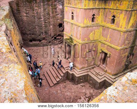 LALIBELA ETHIOPIA - JUNE 26 2016: People visiting Church of Saint George (Bete Giyorgis) Lalibela Ethiopia. Wide angle.