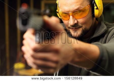Sport shooting range. Science use of firearms. Shooting a gun at shooting range.