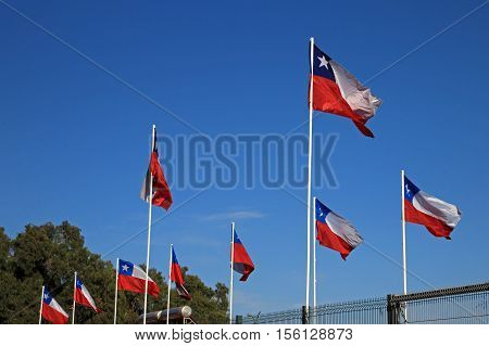 Flags of Chile on the blue sky