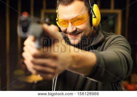 Science use of firearms. Shooting a gun at shooting range