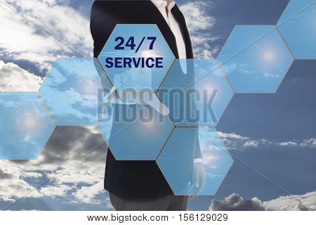 Businessman pressing button 24 hours service icon over, Full time service concept