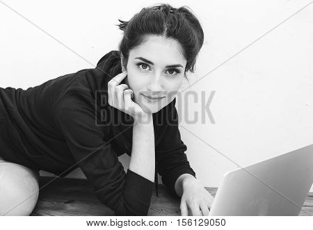 Young Beautiful Woman With Laptop On Floor Black And White.