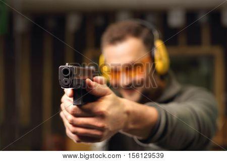 Sport shooting range. The man at the shooting range.