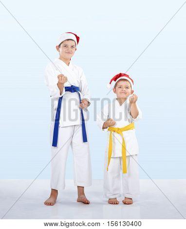 Two karateka stand in the rack of karate