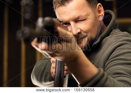 The man at the shooting range. Science use of firearms.