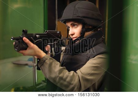 Policewoman at the shooting range with a rifle shot