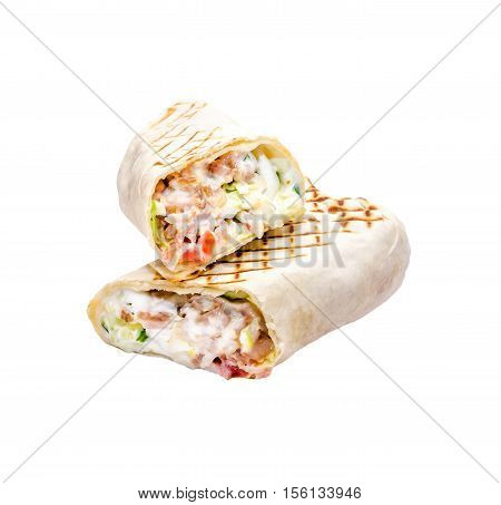 Tasty pita sandwich with lettuce, cheese, chicken fillet, fresh vegetables, mayonnaise, spices on a white background, isolated. Homemade wrap, street food concept. Classic kebab.