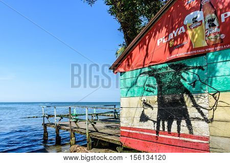 Livingston, Guatemala - August 31 2016: Painted wooden wall of beachside bar in Caribbean town of Livingston Guatemala